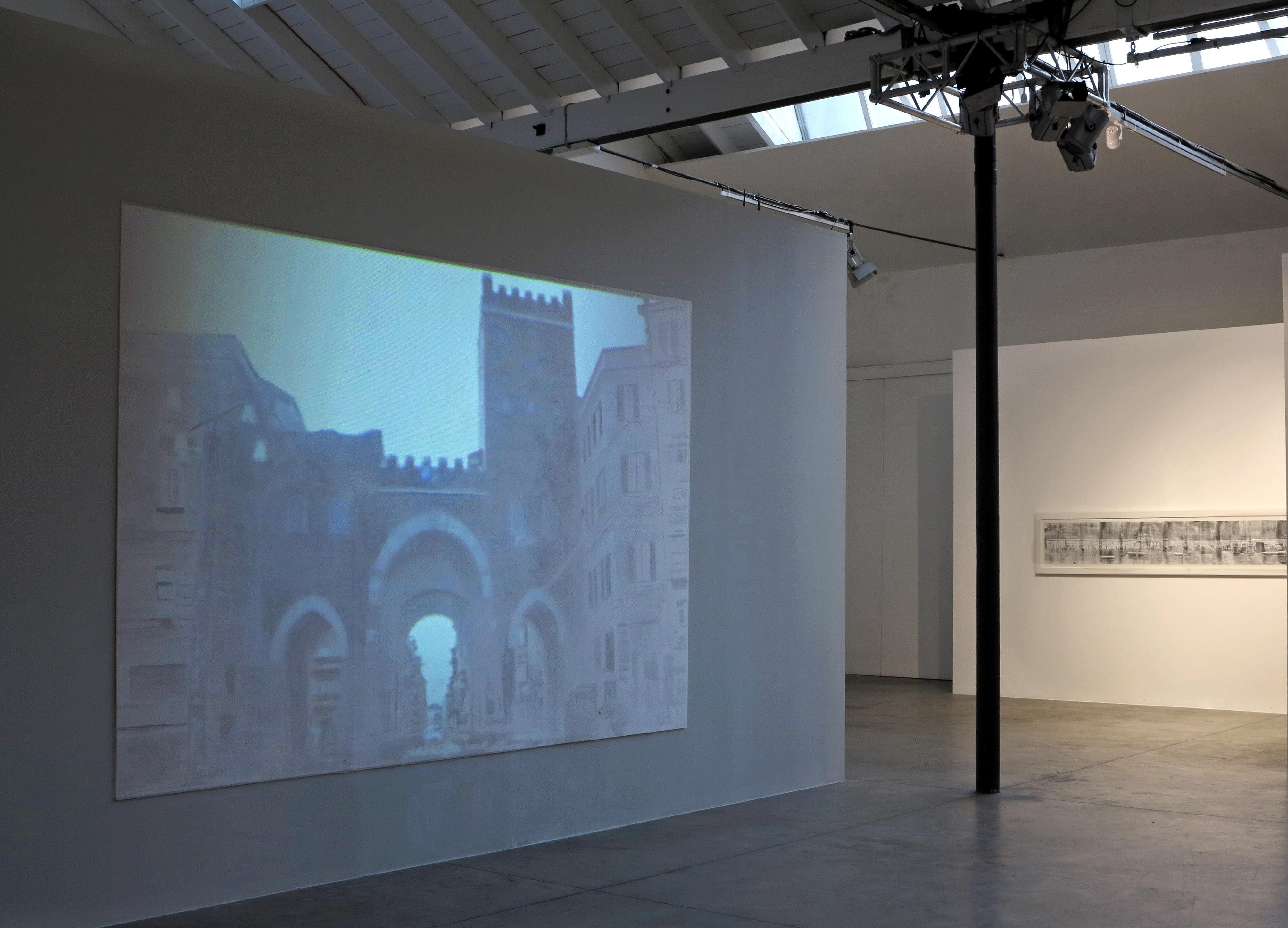 Veduta parziale della mostra porta ticinese videoproiezione e acrilico su tavola 244x366x2cm - Mostra della porta ...